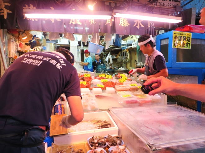 experience the Tsukiji Market during your layover in Tokyo.